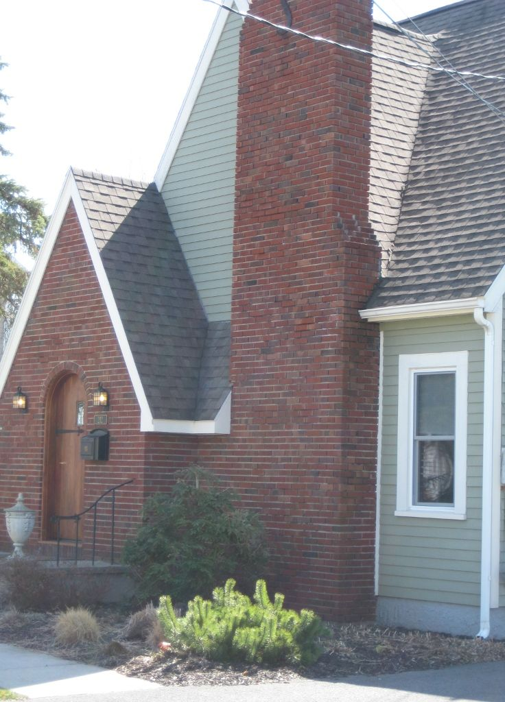 Brick tudor siding trim and roof color roof colors for Tudor siding