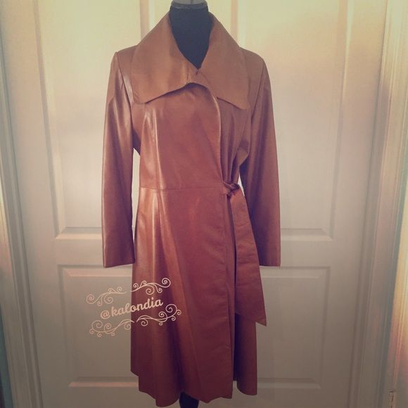 Boutique Leather Dress Length Coat This boutique kid leather coat is a must addition for your wardrobe. It is buttery soft and gorgeous on!!!! So many compliments!!!! Worn a handful of times and in great condition. Boutique Jackets & Coats