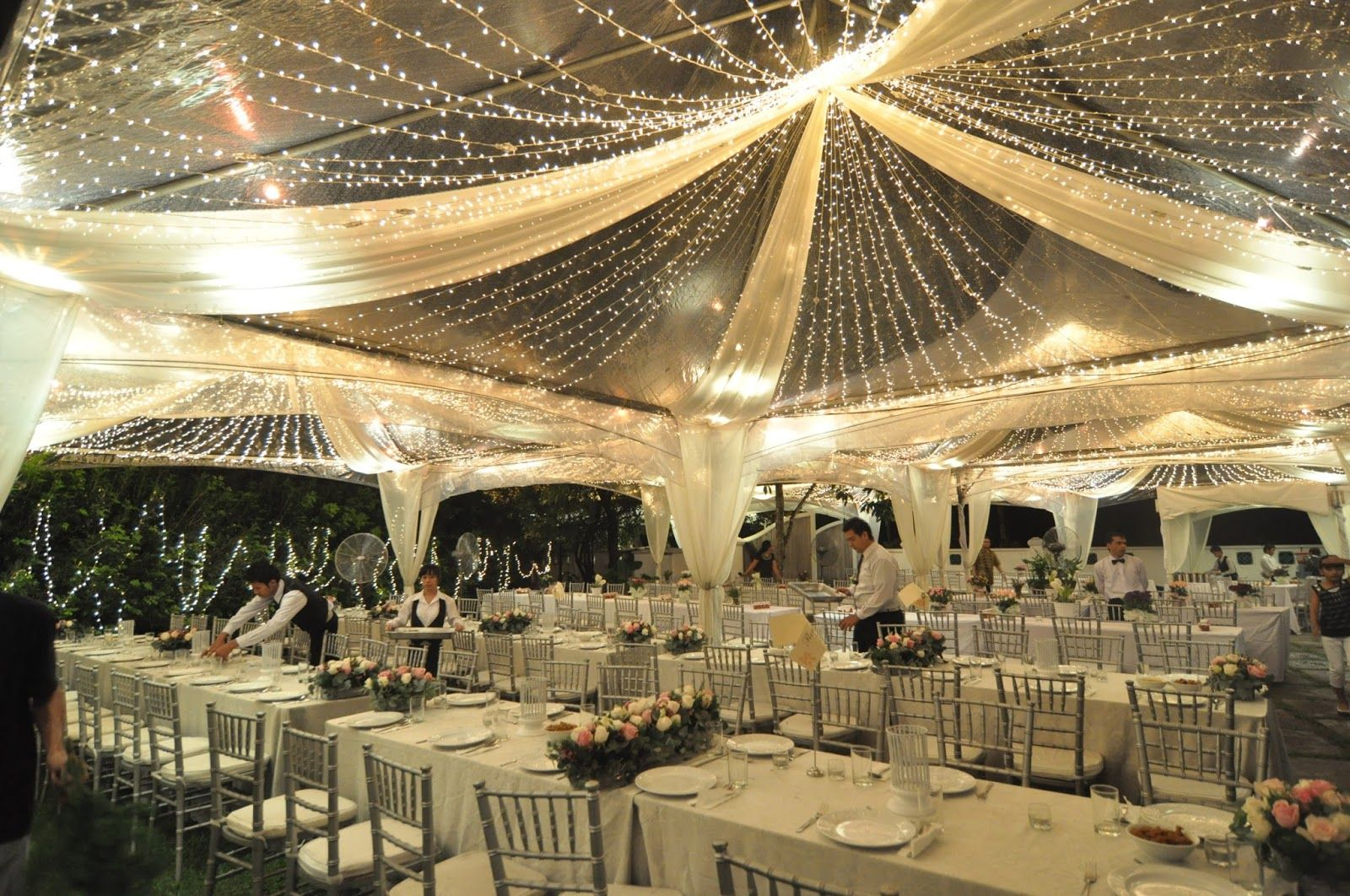 lovely lighting and decor in these clear tents tent