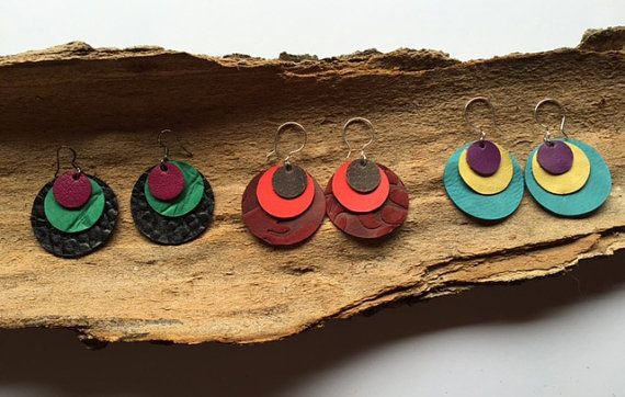Up-cycled leather earrings, made in Vermont. Colorful circle layers. Lightweight. 1.5 Diameter.  If you are looking to match something in particular I am happy to custom design a pair for you for no extra charge.