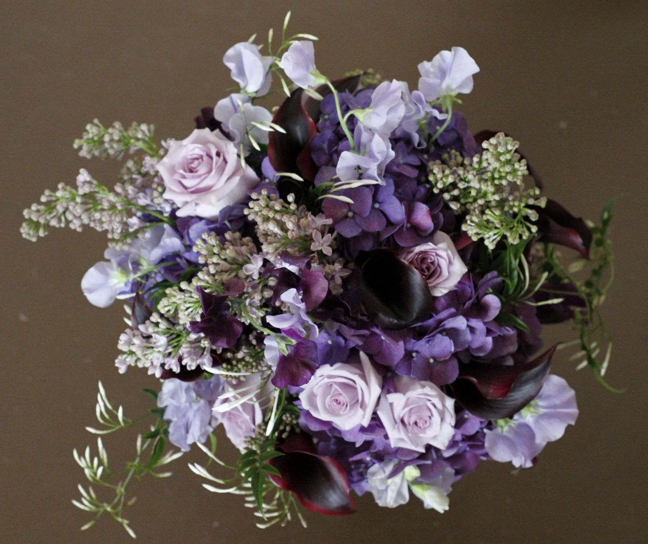 Purple Bouquet With Wedding Flowers Such As Sweet Pea