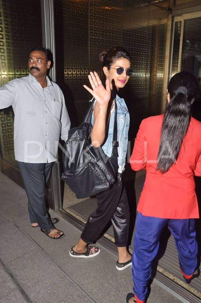 Priyanka Chopra was snapped at the Mumbai airport as the actor left for Los Angeles. Priyanka will be in LA for events related to her television debut 'Quantico'. The first look of 'Quantico' was released recently and has garnered huge interest and appreciation all around with many Bollywood celebrities congratulating their fellow fraternity member for this new endeavour of hers. Priyanka was wearing black pants which she paired with a white sleeveless shirt and a denim jacket. She stopped…