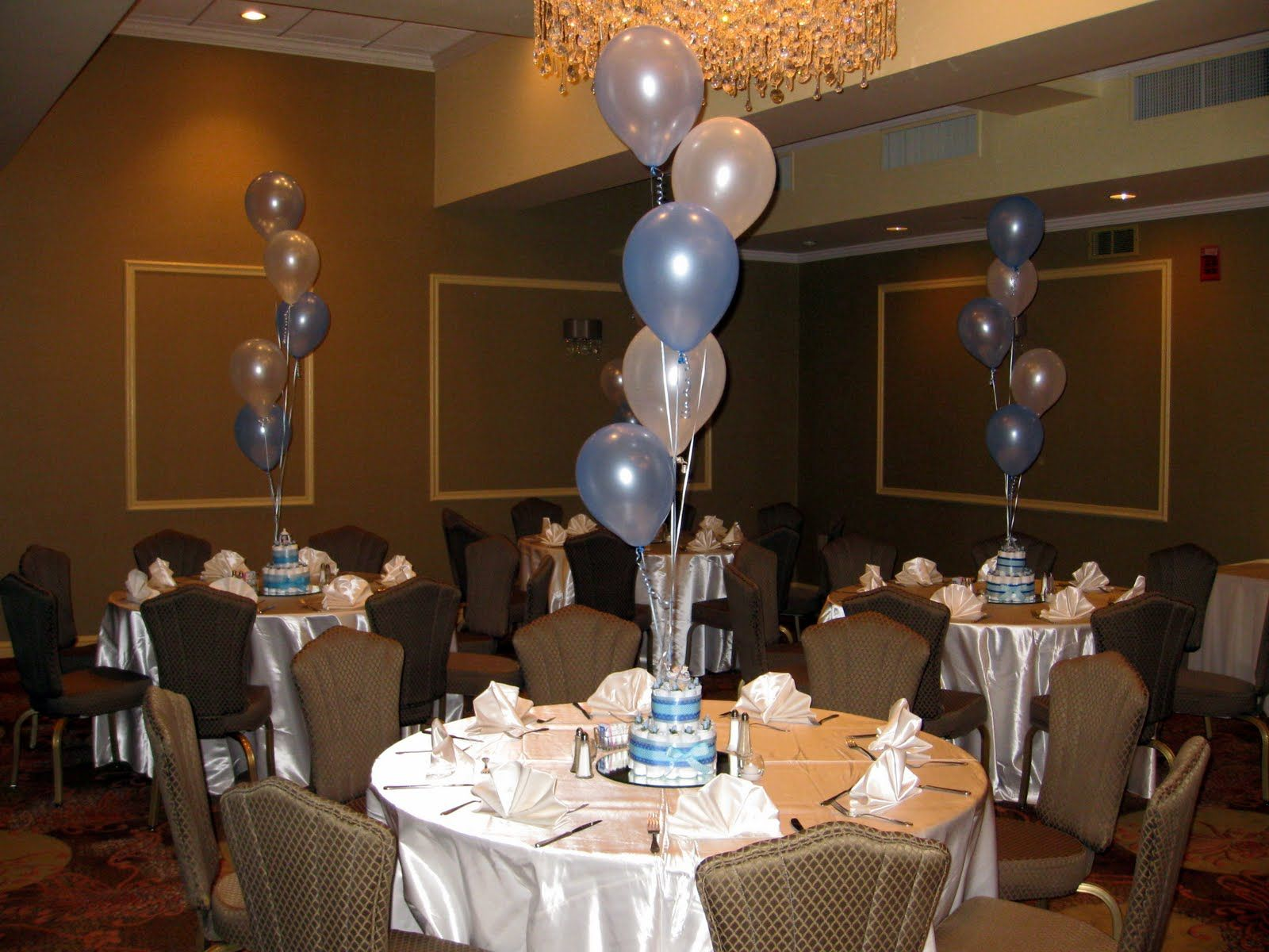 centerpieces for baby showers but balloons attached to vases with