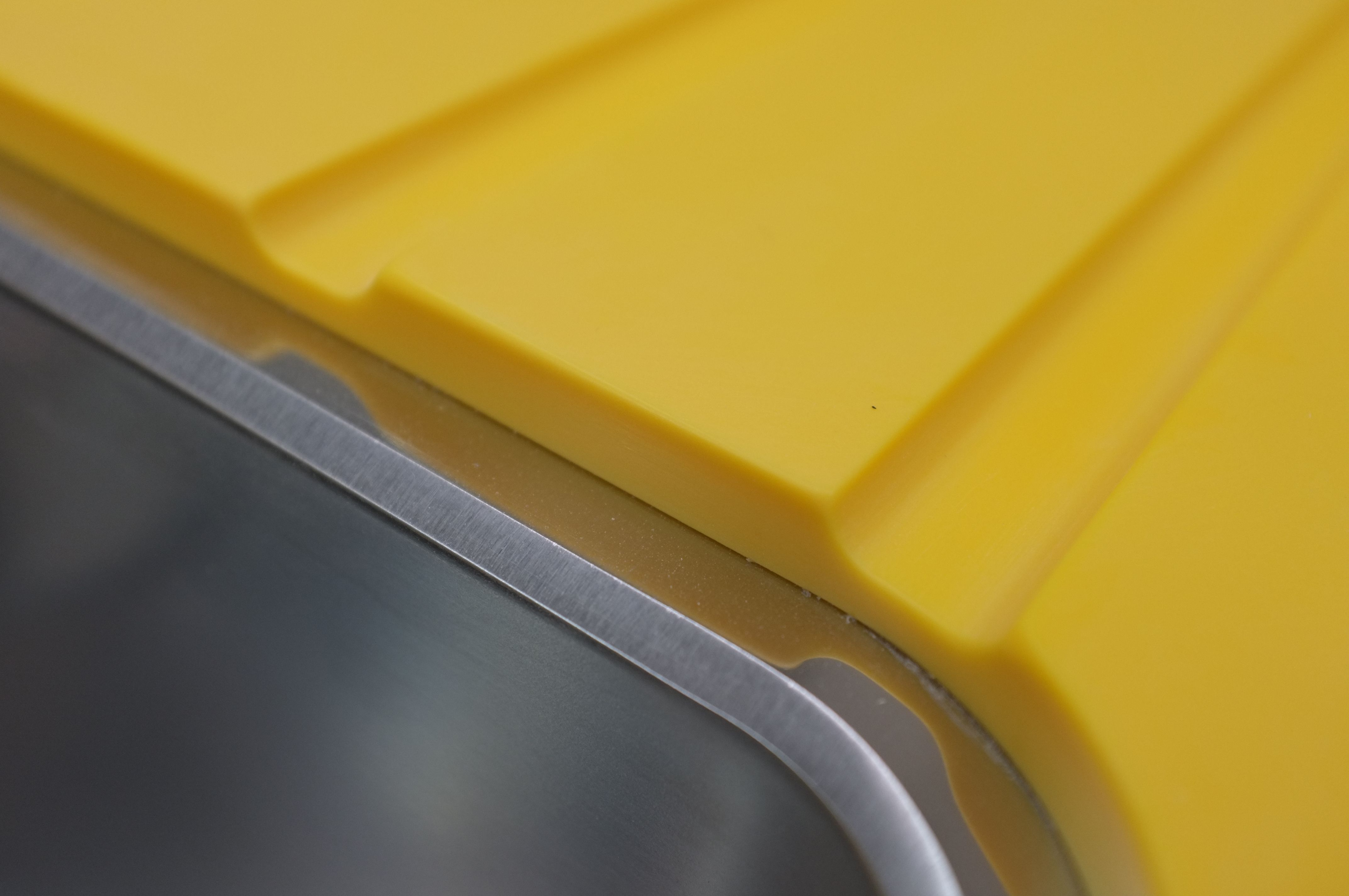 Imperial Yellow Corian, detail shows drainer groove and ...