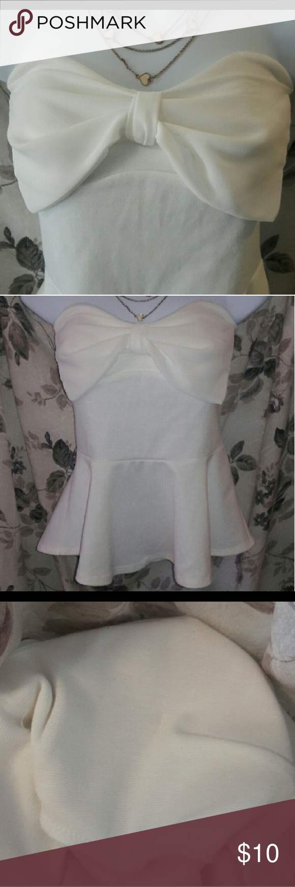 abe12c5439498a NWOT cream peplum top bow 🎀 on front Strapless cream peplum top with super  cute bow detail 🎀 Has built in pads. No flaws. Bundle and save even more  !!!