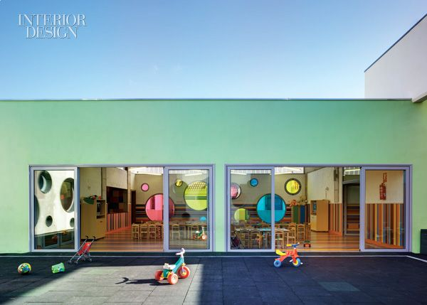 Day Centre by ELAP The multipurpose room's doors slide open to the courtyard. Photography by David Frutos/Bis Images.