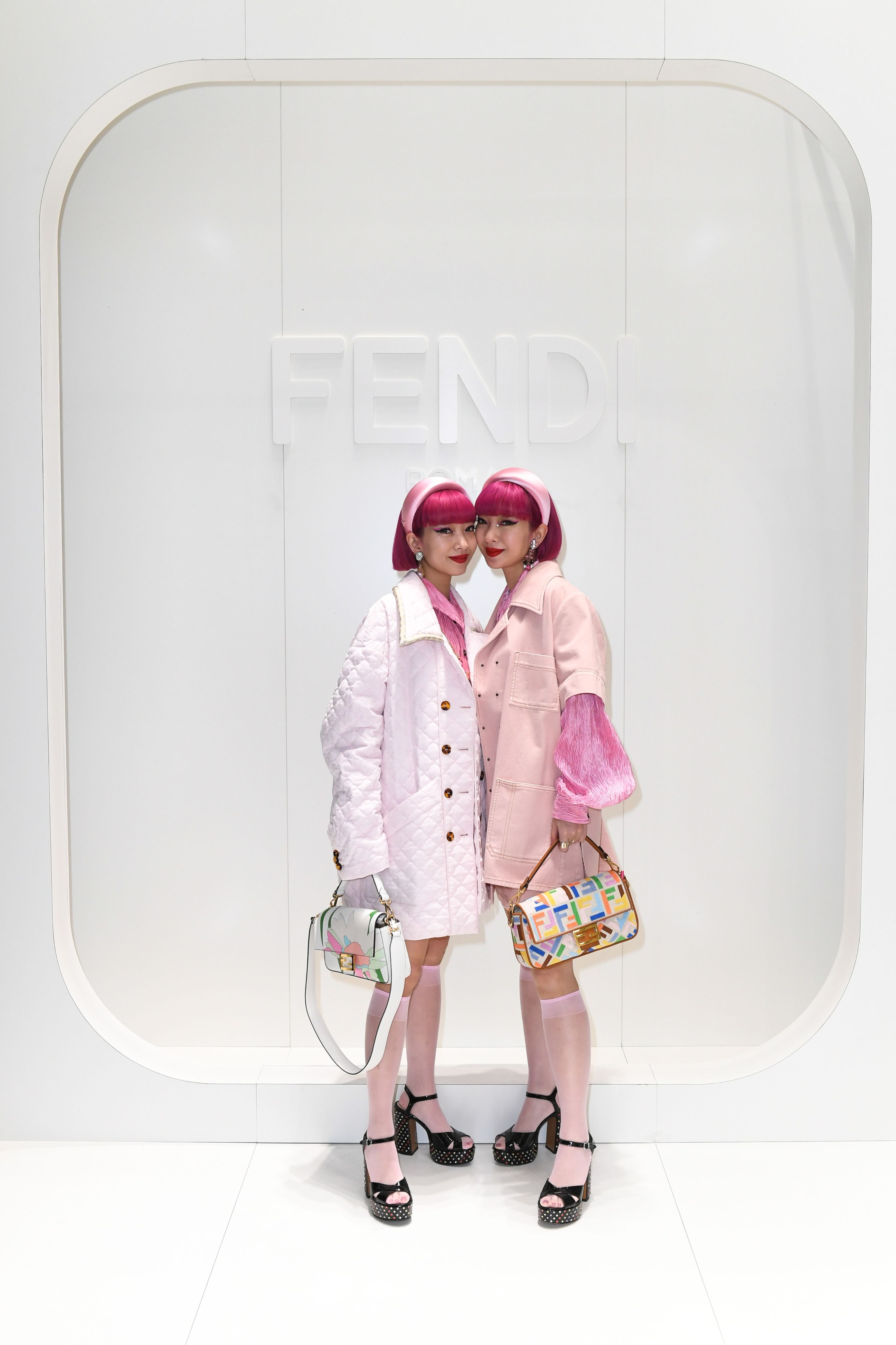Ami and Aya captured together at the Fendi Men's Fall
