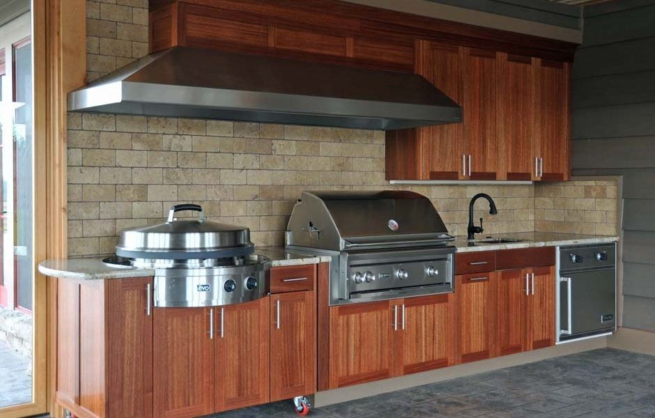 outdoor kitchen with lynx professional grill gorgeous wood panel cabinets large vent hood and a on outdoor kitchen on wheels id=67468