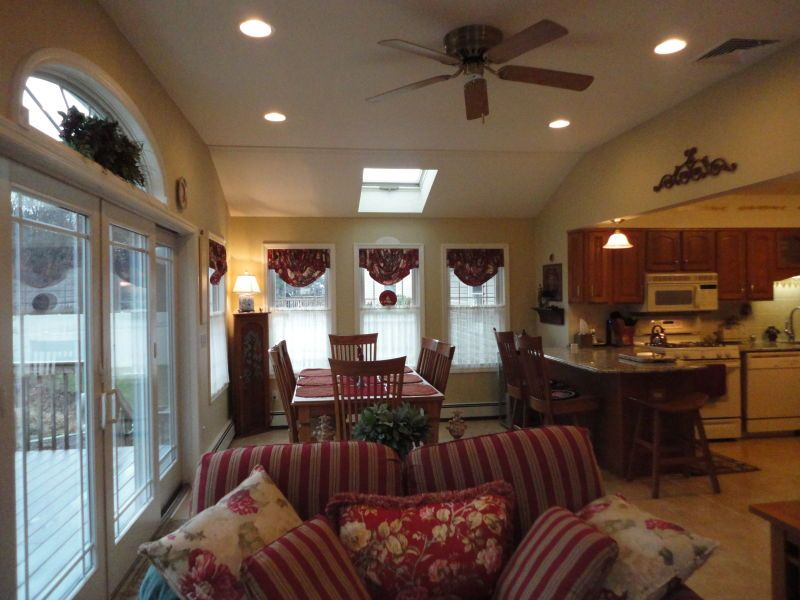 Adding Sunroom Off Back Of Raised Ranch Gives More Comfortable Expanded Room For Dining And A