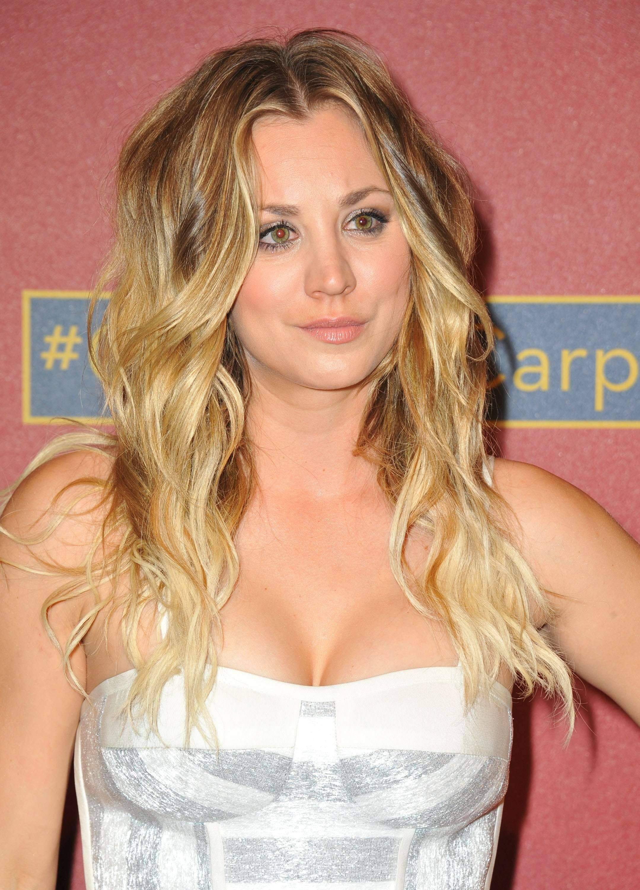 kaley cuoco told cosmopoliton that getting breast implants was the