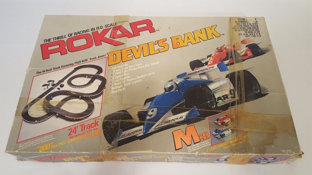 Rokar Slot Cars Two Indy M-cars (Blue & Red)w/Complete Set