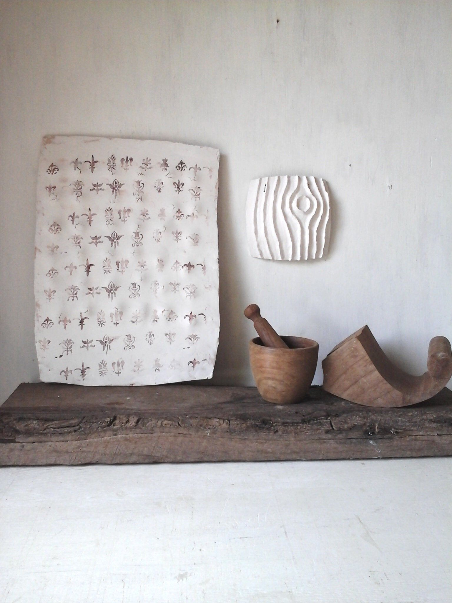 White hanging sculpture ceramic wall art with Florentine flèur-de-lis pattern, rustic Italian decor from Louise Fulton Studio