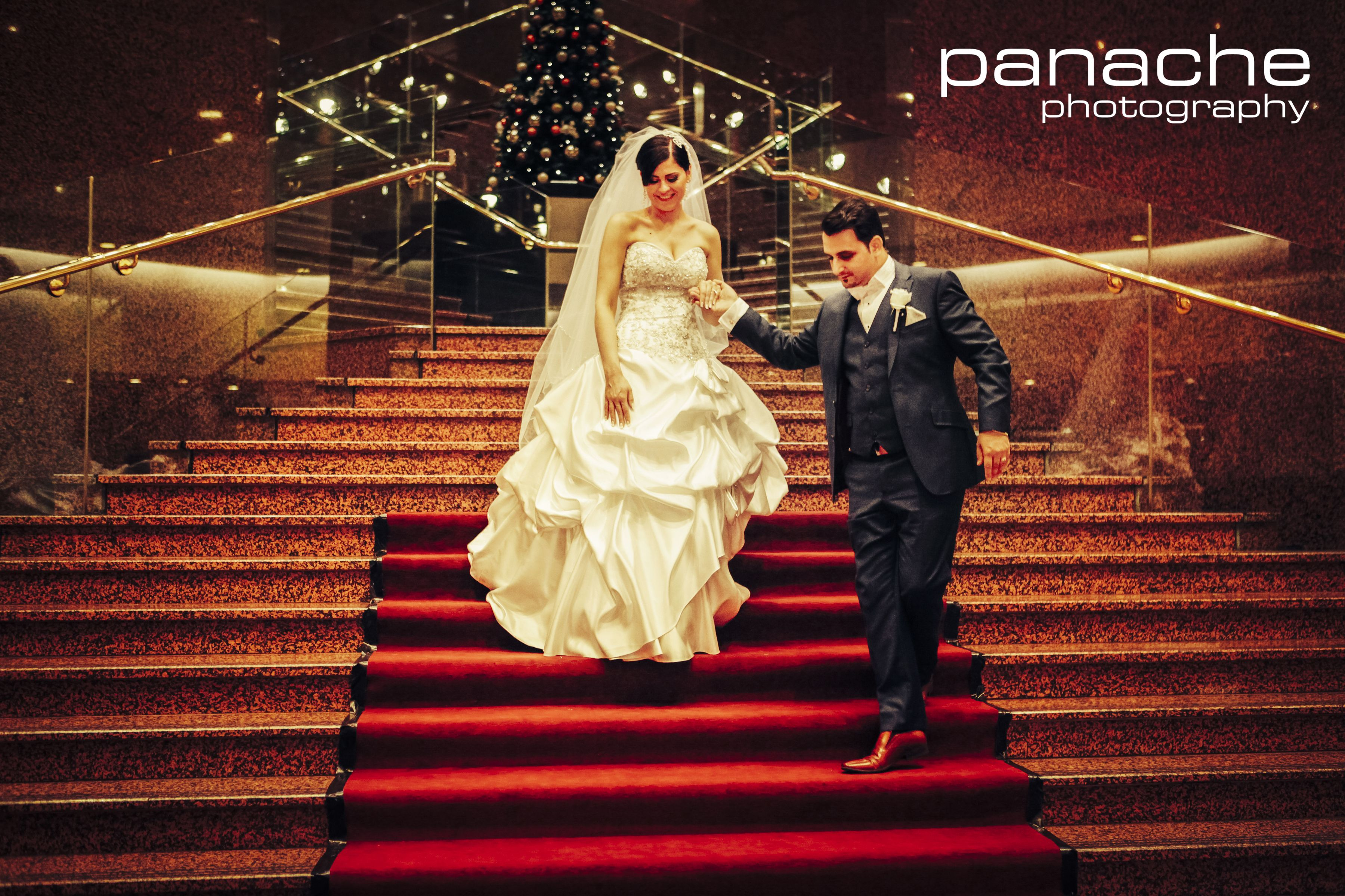 Stunning bride and groom arriving via the grand staircase world