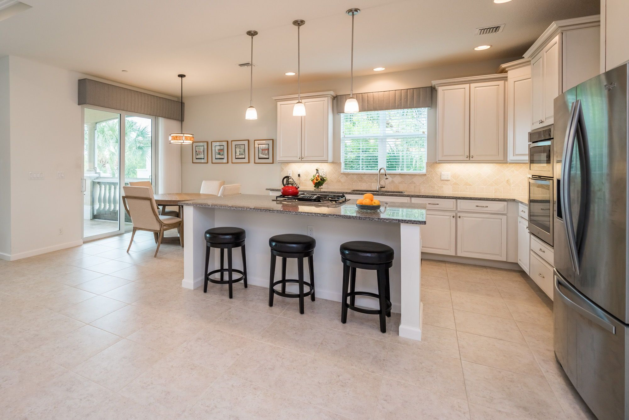 The Kitchen Has Tile Flooring Stainless Steel Appliances A Large Island With Granite Countertops 42 Kitchen Decor Cabinets With Crown Molding Kitchen Design