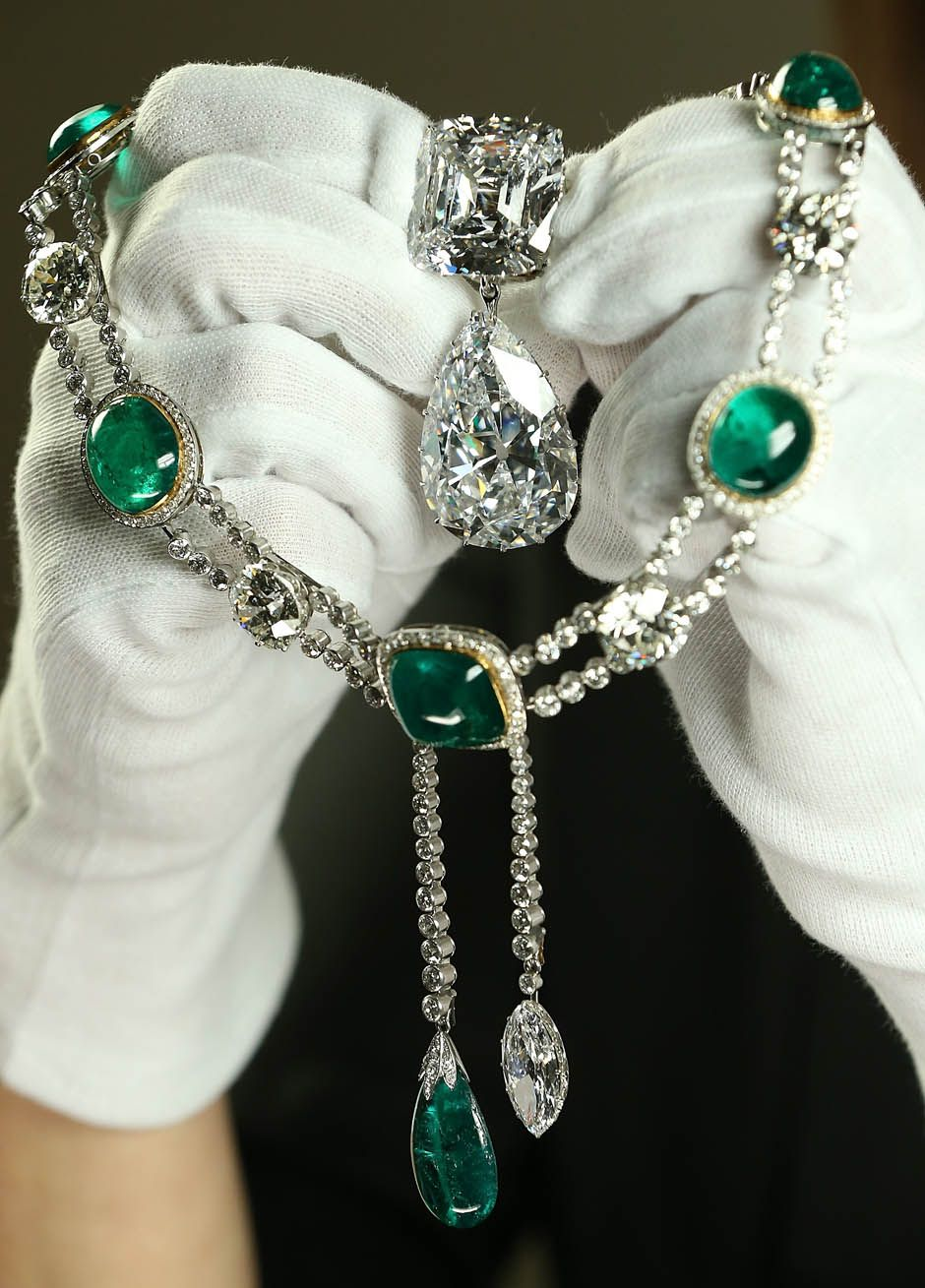 Queen Elizabeth's jewelry Is Prepared for the Jubilee Exhibition.  Emerald and diamond necklace and the Cullinan III and IV brooch.