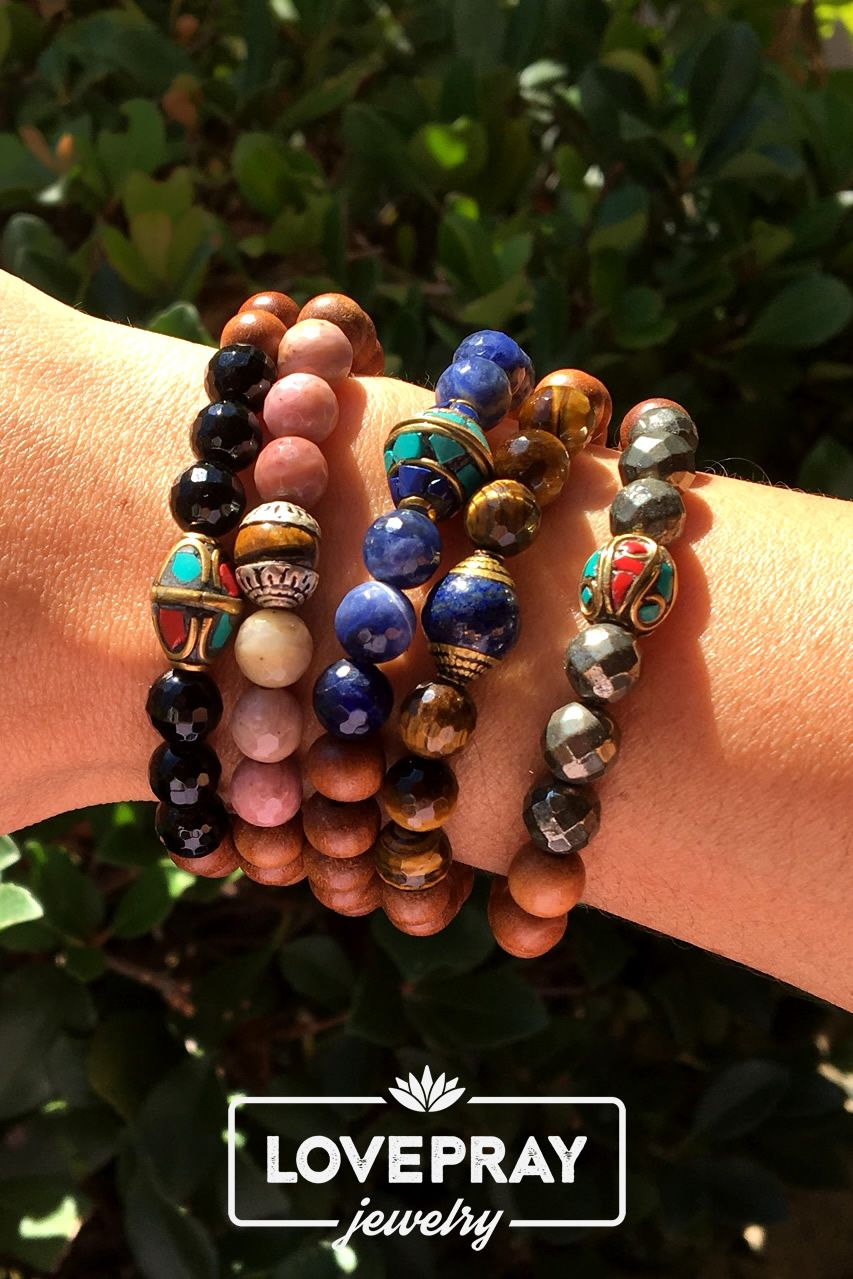 New, Rich faceted gemstones with hand made Tibetan guru beads paired with healing aromatic sandalwood bracelets. #armcandy
