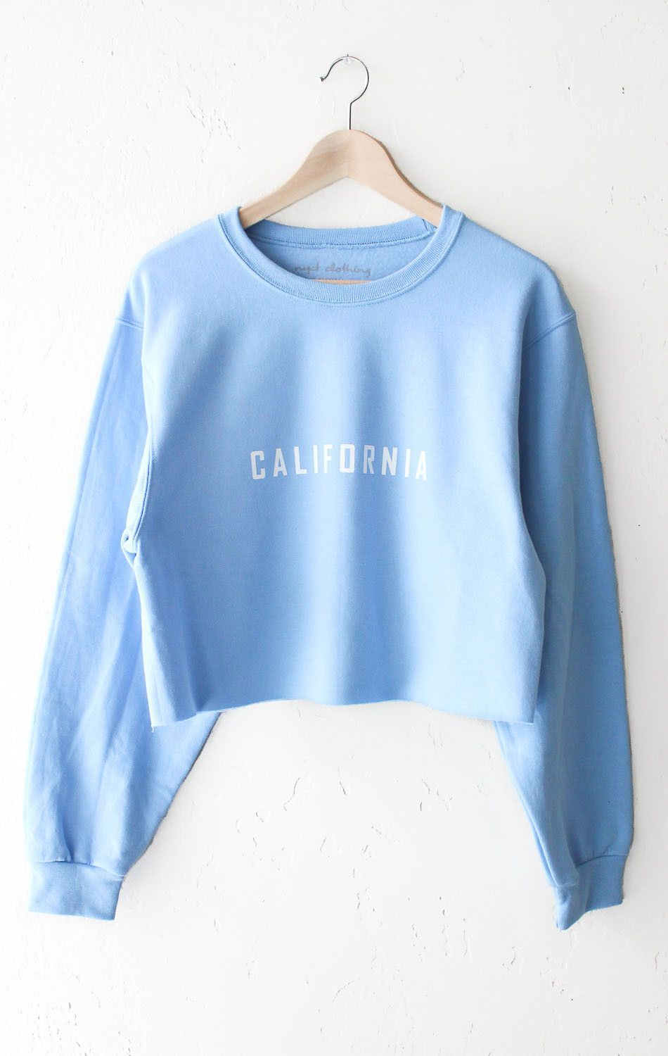 e15b19d56ea1a8 Description Details   California  cropped sweater in light blue. Brand   NYCT Clothing. Unisex