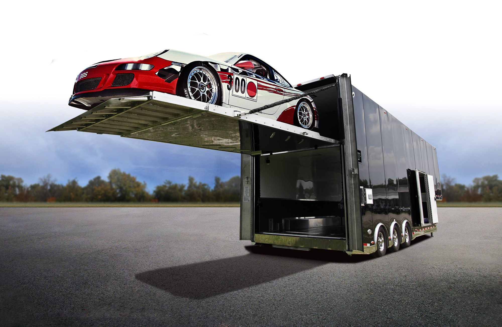 Custom stacker car hauler with a ramp door that doubles as a lift ...