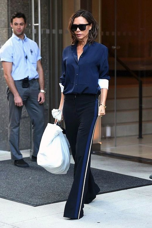b220db84c64 Photo via  Star Style Victoria Beckham dominated the side-stripe pant trend  and we re taking detailed notes on her sporty