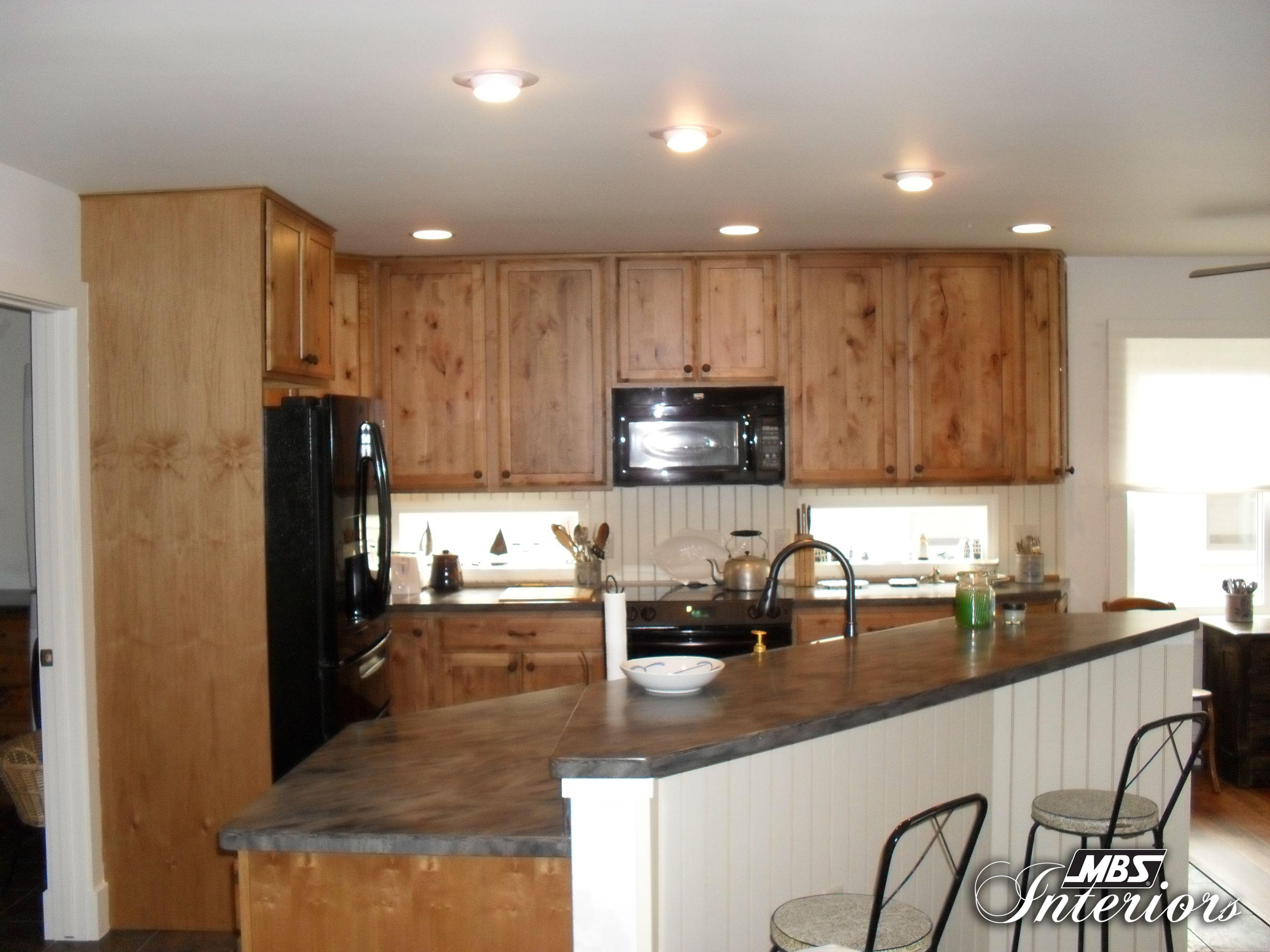 Perimeter StarMark Cabinetry Arlington door style in Cherry