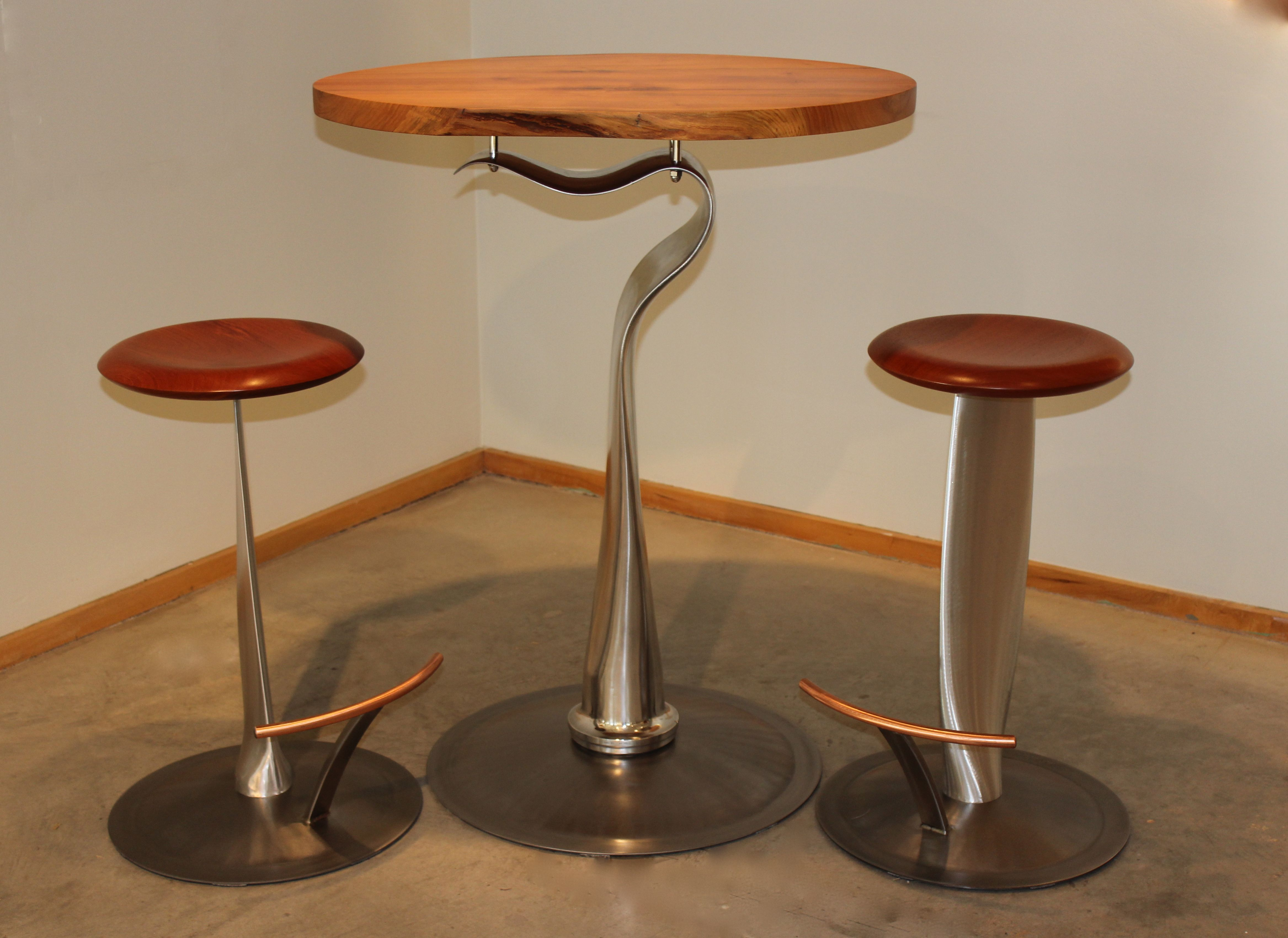 De Haviland bar table and Propeller stools made from salvaged