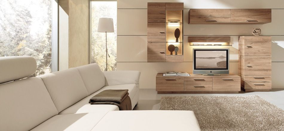 living room with wooden furniture like entertainment unit and white sectional sofa