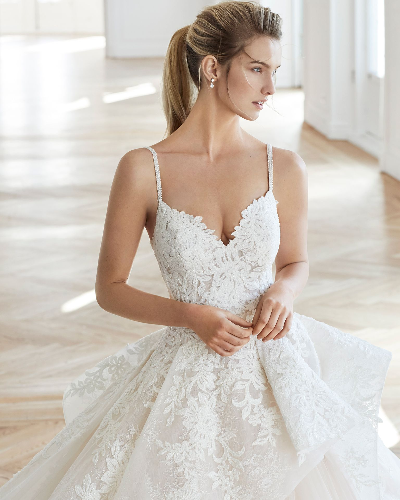 c04acc1297 Princess-style beaded lace and tulle wedding dress. Sweetheart neckline and full  skirt. Available in natural/rose and natural.
