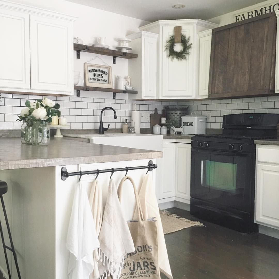 "Kaley on Instagram: ""I'm really loving our little farmhouse kitchen these days. Especially since we added the wooden hood vent and our tea towel rack. Makes me…"""