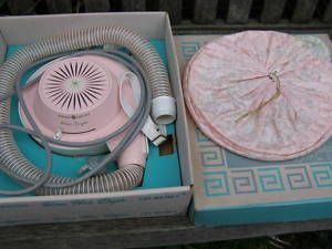 The hair dryer with bag and hose....my mom used this all the time!