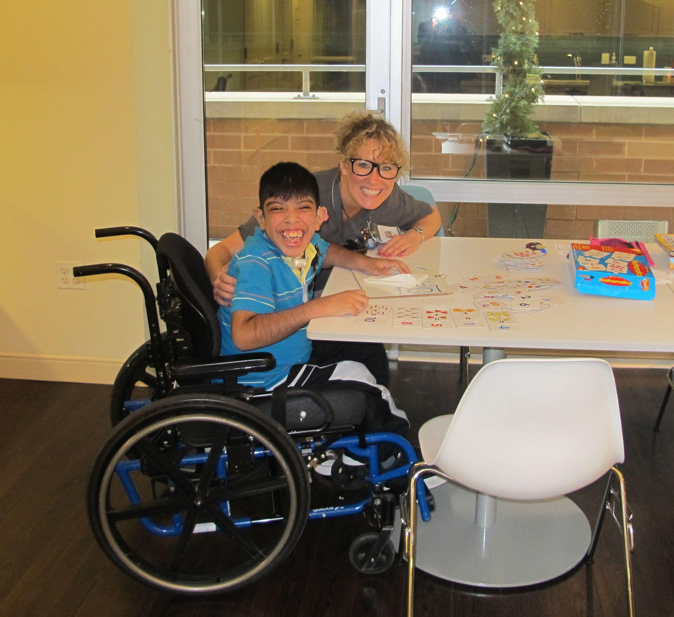 Fernando and his teacher at ahk chicago respite care