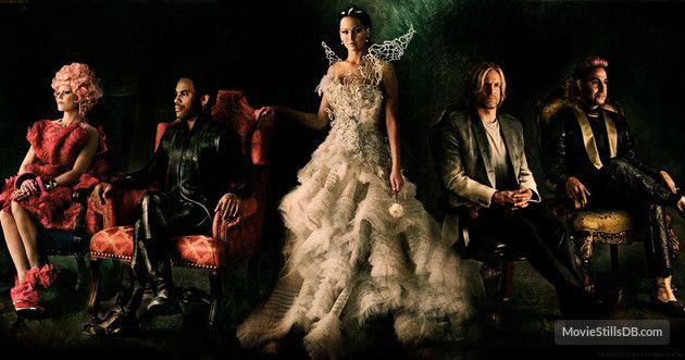 Caesar, Cinna, Haymitch, Effie and Katniss