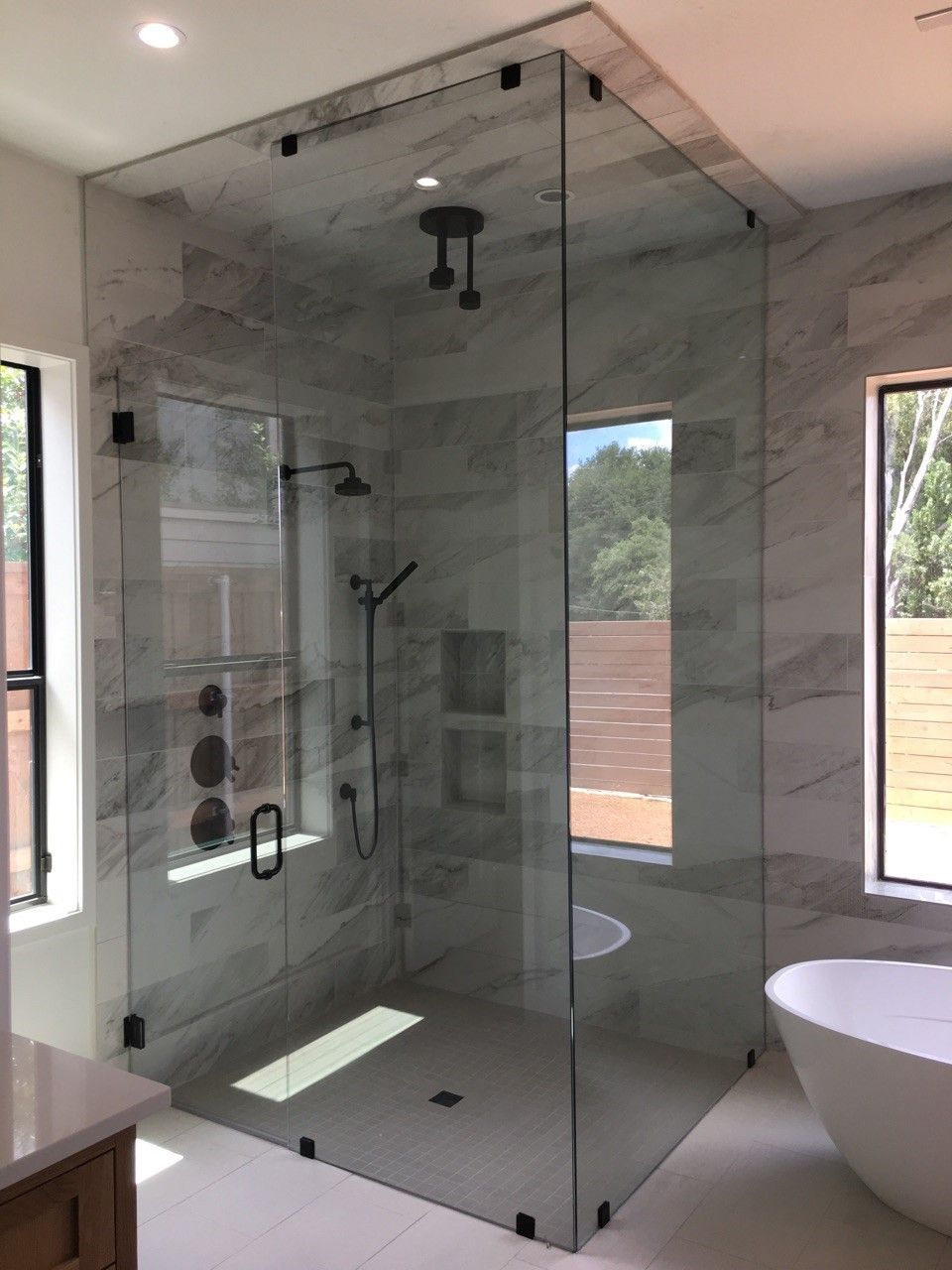 Westside Manor | Frameless glass shower enclosure featuring Brizo ...