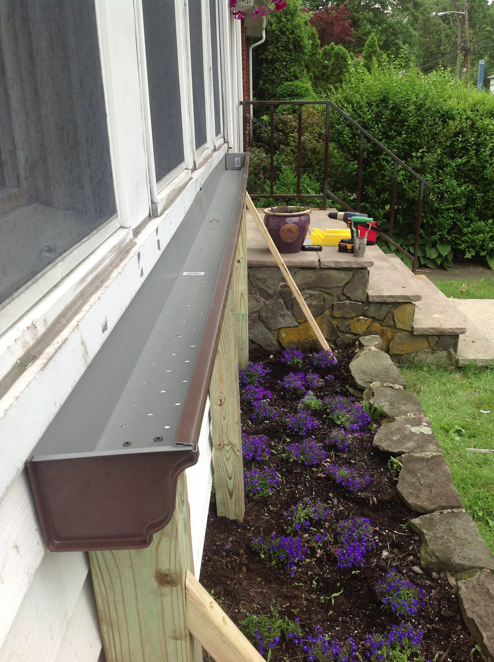 "This is my ""No Drill"" answer to flower boxes on the front"