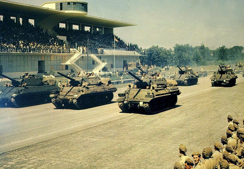 General Mark W. Clark (15th Army Group) takes the salute from M-10 tank destroyers of the 11th Armoured Brigade of the 6th South African Armoured Division at the commemoration parade marking the end of hostilities in Italy. Monza Race Circuit: 14 July 1945
