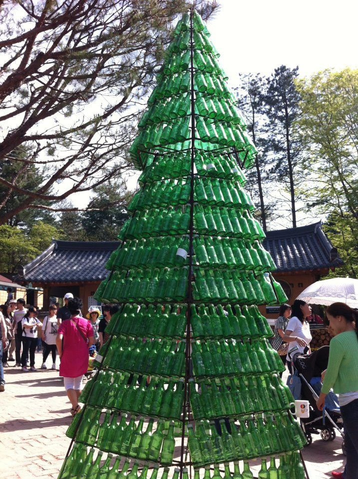 We found this Soju bottle tree in '남이섬(Nami seom / Nami Island). As everybody knows, Soju is the national alcohol of Korea. Wonder who drank all these!? #Korea #korean