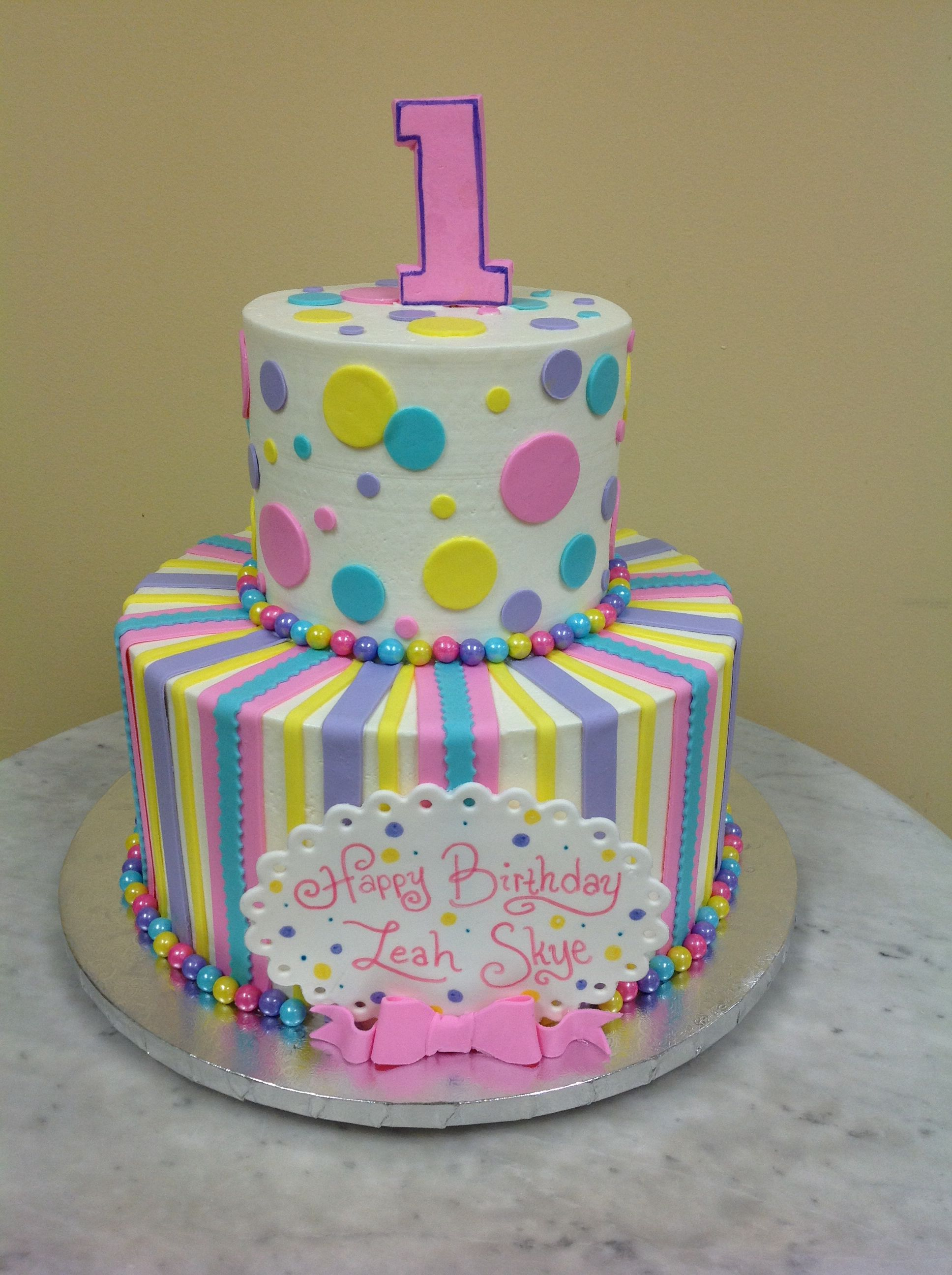 Colorful and cute first birthday cake with images cake
