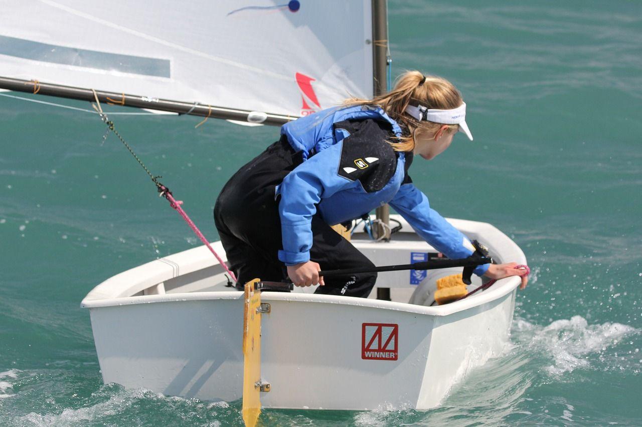 Boat sailing optimist ioda sun sea sail boat