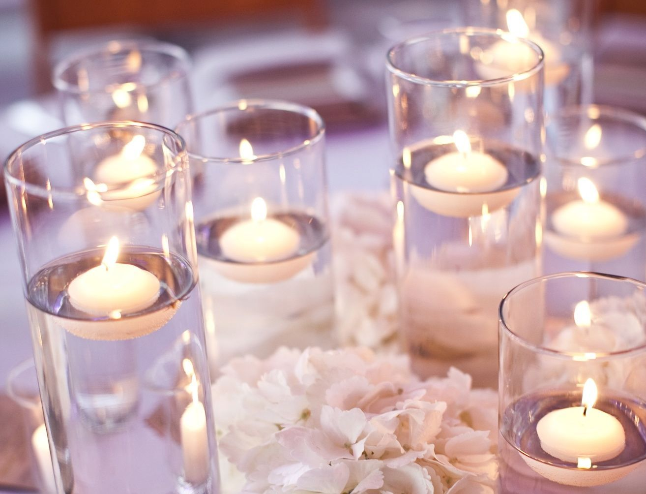 Skinny Cylinders With Gold Swirls And Floating Candles And