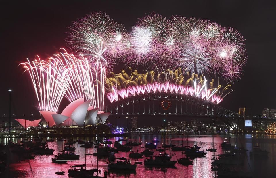Fireworks explode over the Opera House and the Harbour