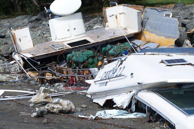 Damaged boats at Algies Bay. Photo / Aaron Griffiths