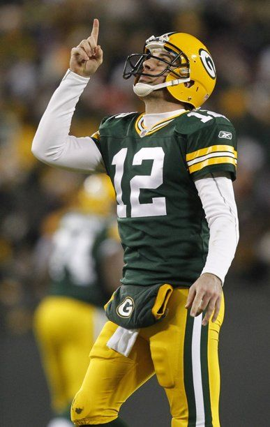File This Dec 25 2011 File Photo Shows Green Bay Packers Quarterback Aaron Rodgers Celebrating A Green Bay Packers Green Bay Packers Fans Packers Football