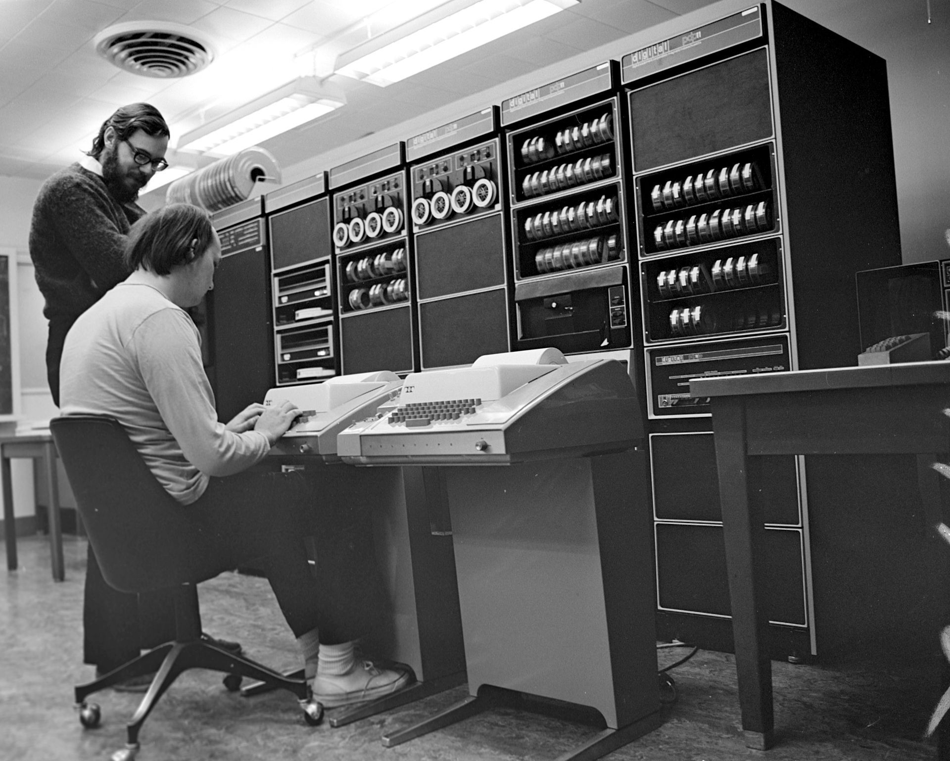 Ken Thompson (sitting) and Dennis Ritchie at PDP-11