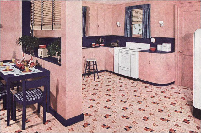 1940 Pink Nairn Linoleum Kitchen ~ This Nairn ad ran in theAmerican Homemagazine and it's really pink. The combination of pink and navy blue isn't uncommon but the amount of pink is. Even the ceiling is a lighter shade. It really makes those white appliances and red accessories pop.