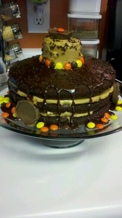 Chocolate cake with peanut butter frosting and a chocolate glaze.. Decorated with candy and sprinkles.