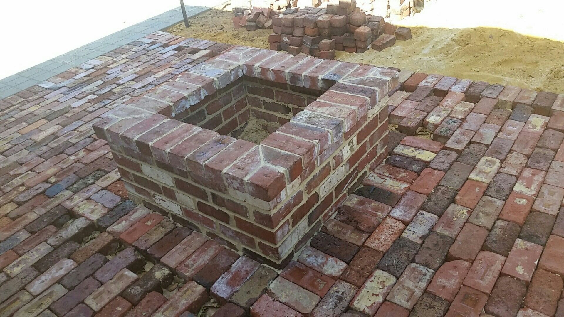 How to make a fire pit with red bricks