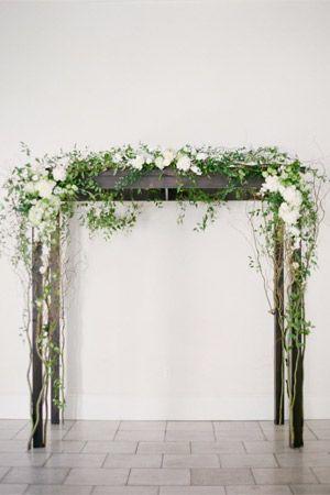 minimalist wooden wedding arbor with white florals ferns brides