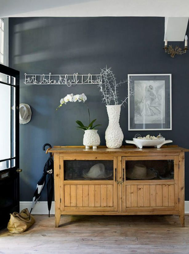 Grey wall, combination with wood and decorate with white and naturals.