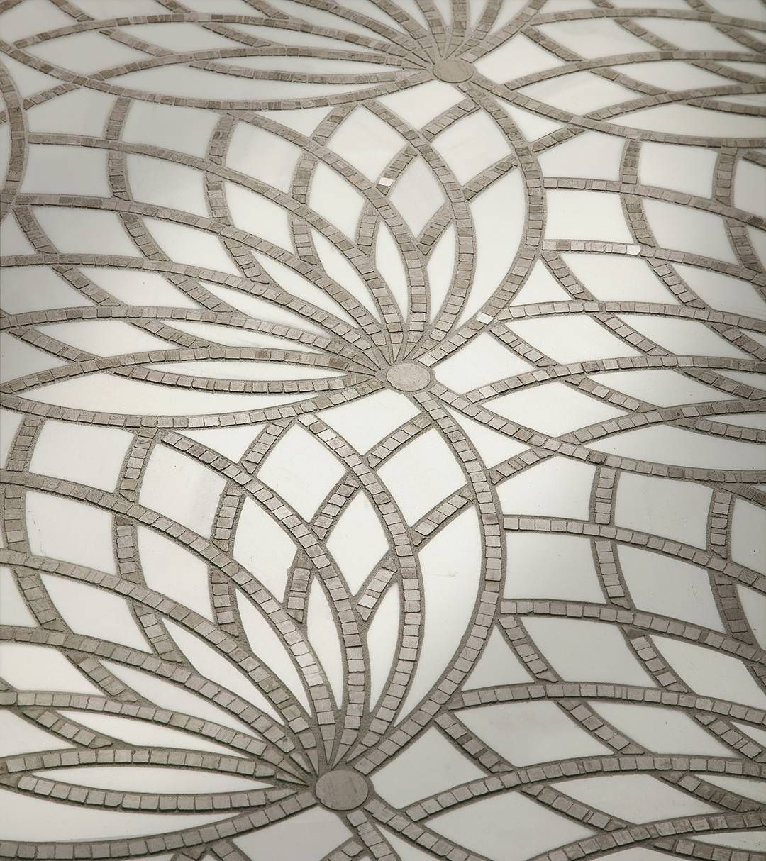 New an ancient egyptian symbol of rebirth the lotus flower is an ancient egyptian symbol of rebirth the lotus flower is drawn in tesserae mosaics across a smooth background of waterjet cut marble melding old world izmirmasajfo