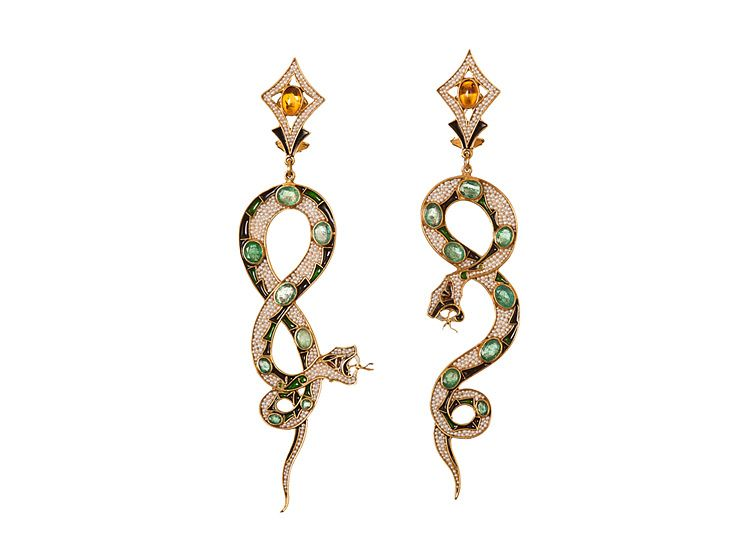 Emerald and amber earrings, by Percossi Papi, in the form of striking snakes, symbols of attack and danger.