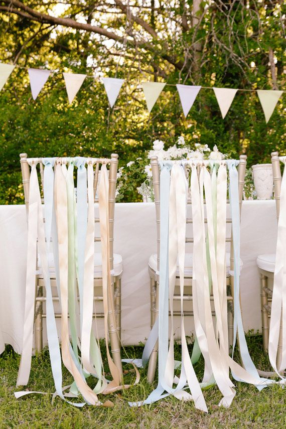 Five Ways To Make Chairs Stand Out At A Party Ribbon Back Chairs Decorating Party Cha Garden Party Decorations Wedding Chair Decorations 1st Birthday Parties